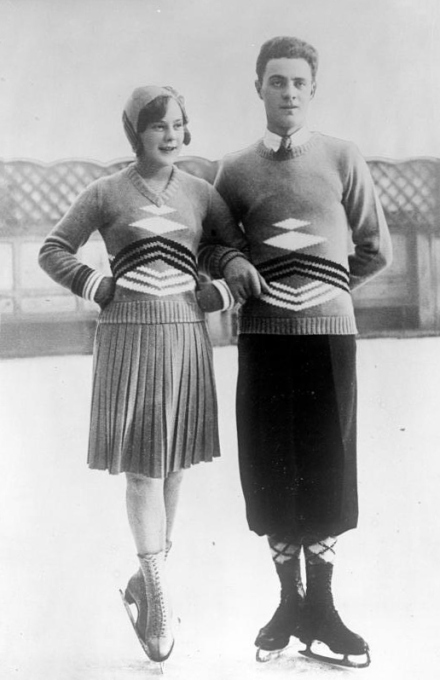 1932 Photograph of a male and a female ice skater, each wearing a multi-coloured, graphic design, intarsia sweater.