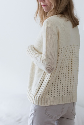 Knitted sweater with mesh lace back. Knitting pattern: Rhilea by Suvi Simola.