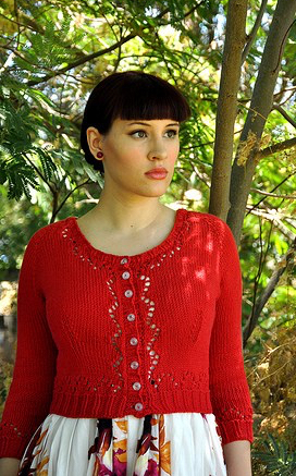 Vintage style, red lace cardigan with shallow scoop neck.