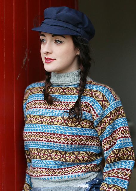 Yule by Susan Crawford- a vintage style, polo neck jumper with all-over Fair Isle design in blue, grey and mustard.