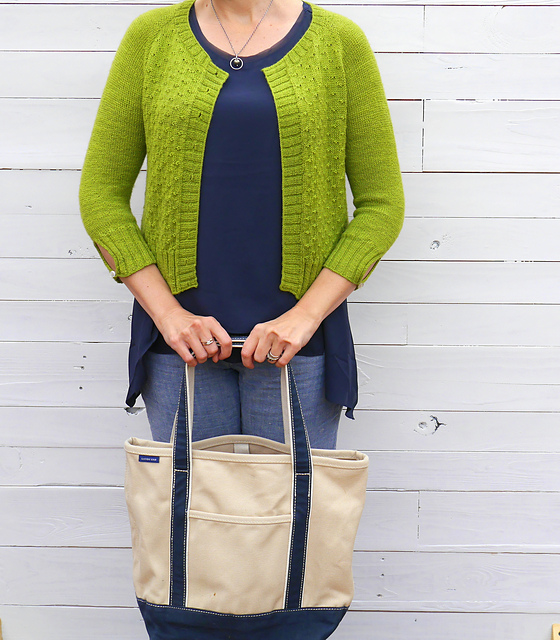 Short, lime green knitted cardigan with textured details.