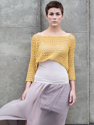 Cropped, knitted sweater with wide boat neck and all-over mesh lace. Knitting pattern: Nijo by Berroco Design Team