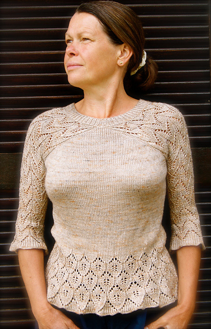 Knitted, crew neck sweater with lace sleeves and details. Knitting pattern: Rosina Pullover/Rosina Sweater by FadenStille