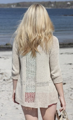 Knitted long cardigan with mesh lace panels. Knitting pattern: Sandshore by Alicia Plummer