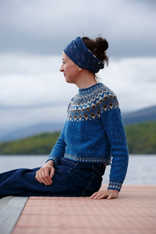 blue sweater with Fair Isle colour work yoke and borders, designed by Kate Davies.