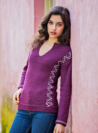"Sweater inspired by traditional ""poveiras"" sweaters with embroidery detail, designed by Filipa Carneiro."