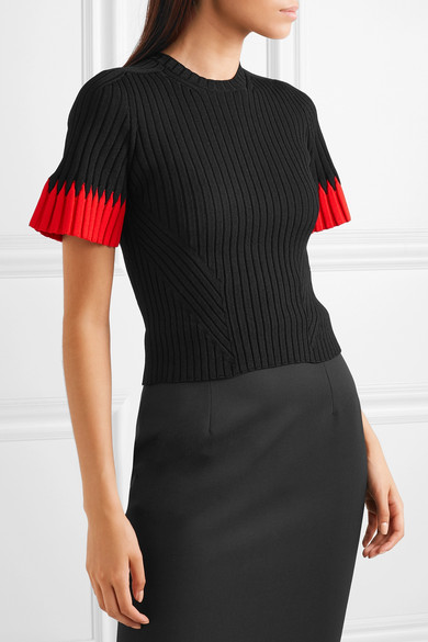 Alexander McQueen black, rib knitted top with flared short sleeves with contrast red edging.
