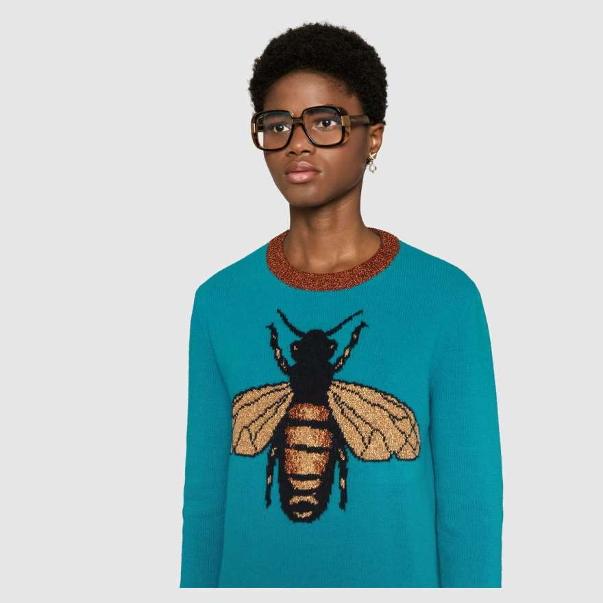 Gucci turquoise wool sweater with intarsia bee motif with brown trim.