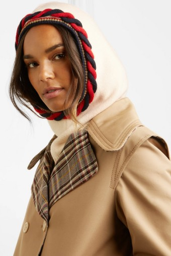 Cream, knitted snood with navy and red braided edging, by Gucci.