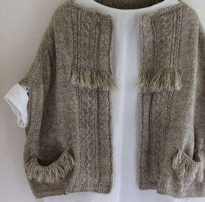 Oversized, boxy sweater with cable and fringe detail, by Junko Okamoto.