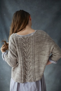 Oversized, cropped sweater with central cable motif and textured all-over finish. Designed by Norah Gaughan.