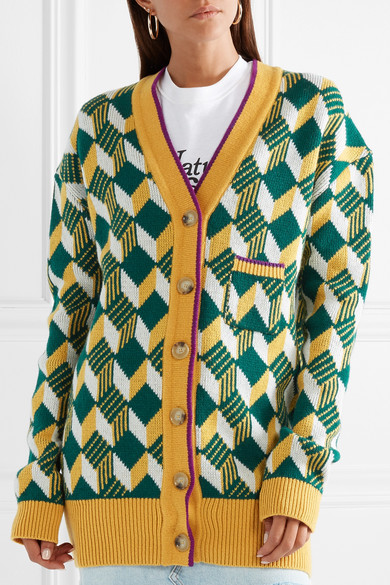AlexaChung oversized, v-neck cardigan with all-over, geometric intarsia design in green, white, yellow and burgundy, with contrast edge in yellow and burgundy.