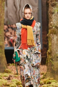 Chanel colour block, long shawl in yellow, brown and orange, worn bundled around the neck.