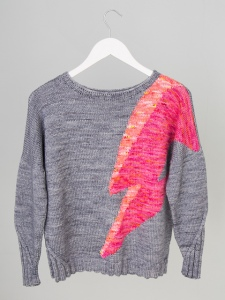 Oversized sweater with lighting bolt motif in intarsia, designed by Sue Stratford.