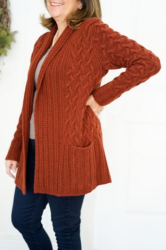Oversized cardigan with all-over cable texture and shawl collar, designed by Lori Versaci.