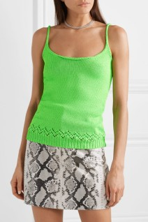 Model wearing neon green tank top with lace detail at hem and rolled, scoop neck from Les Reveries. Worn with snakeskin effect mini skirt.