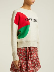 Woman wearing relaxed fit, knitted sweater in cream, with red and green intarsia circle across side and Marant logo across front.