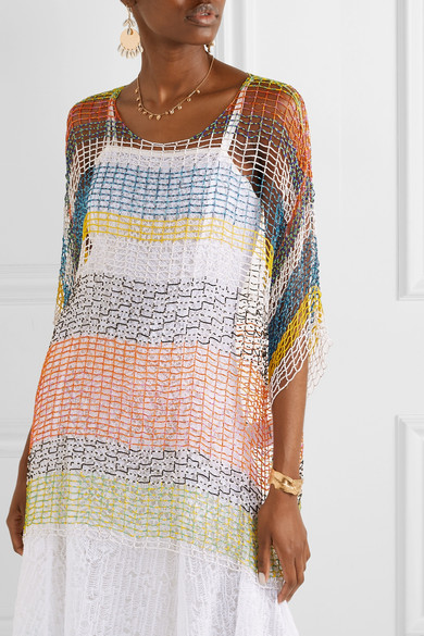Model wearing Missoni oversized, multicoloured, knitted top with mesh fabric, worn over white dress.