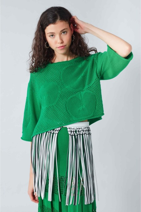 Model wearing cropped, oversized, cotton mesh front sweater with inset apple motifs. From Sonia Rykiel Summer 2019.