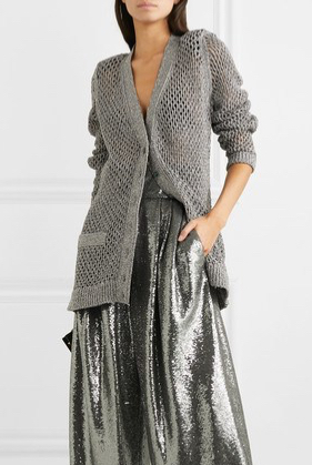 Model wearing Marc Jacobs long, oversized cardigan with allover lace mesh detail – worn with metallic silver trousers
