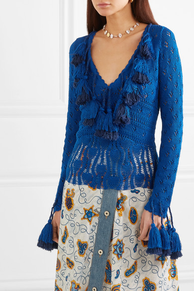 Deep blue, knitted cotton cardigan with lace details at hem and along arms and with oversized tassels edging v-neck collar.