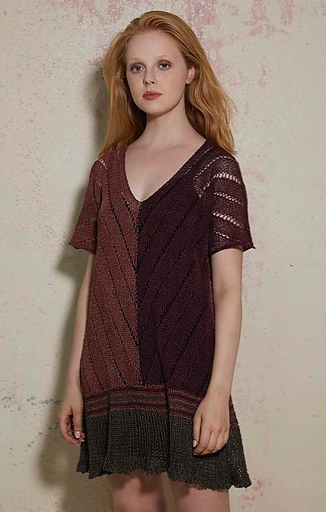 Woman wearing short, knitted dress with deep v-neck, short sleeves and with lace and intarsia colour blocking in brown shades.